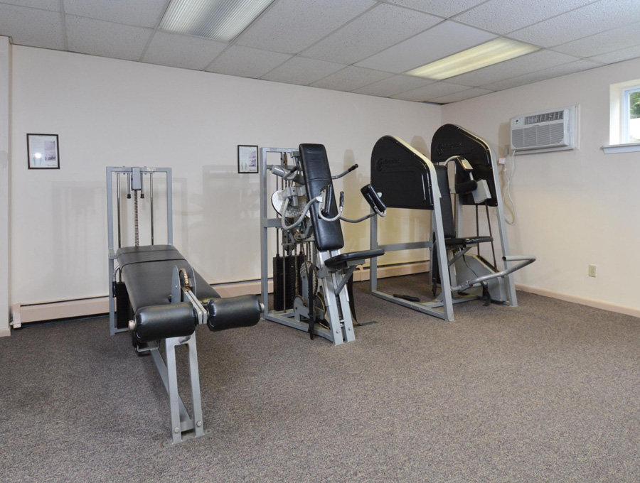 Weight equipment inside the Bishop Hill Apartments fitness center in Secane, PA
