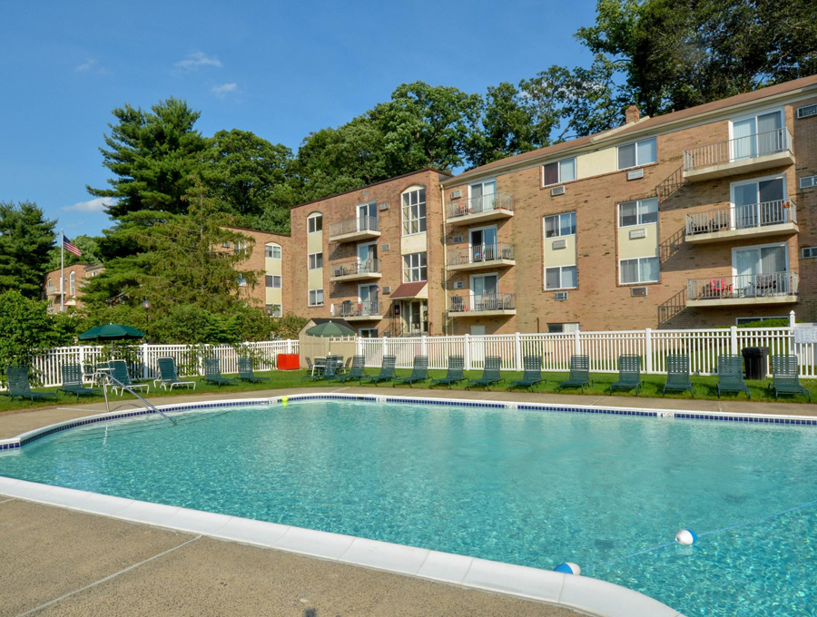 In Ground Pool with Night Lights and Sun Deck at Bishop Hill Apartments in Secane, PA