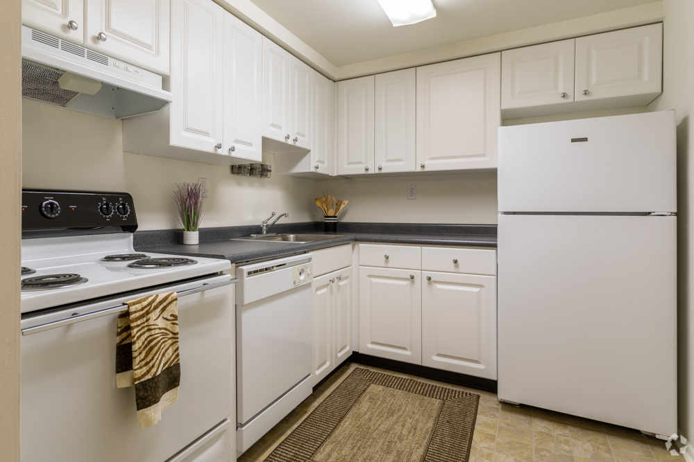 White kitchen with ample storage in Secane, PA's Bishop Hill Apartments