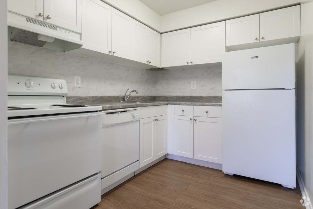 Large white kitchen with dishwasher at Bishop Hill apartments in Secane, PA