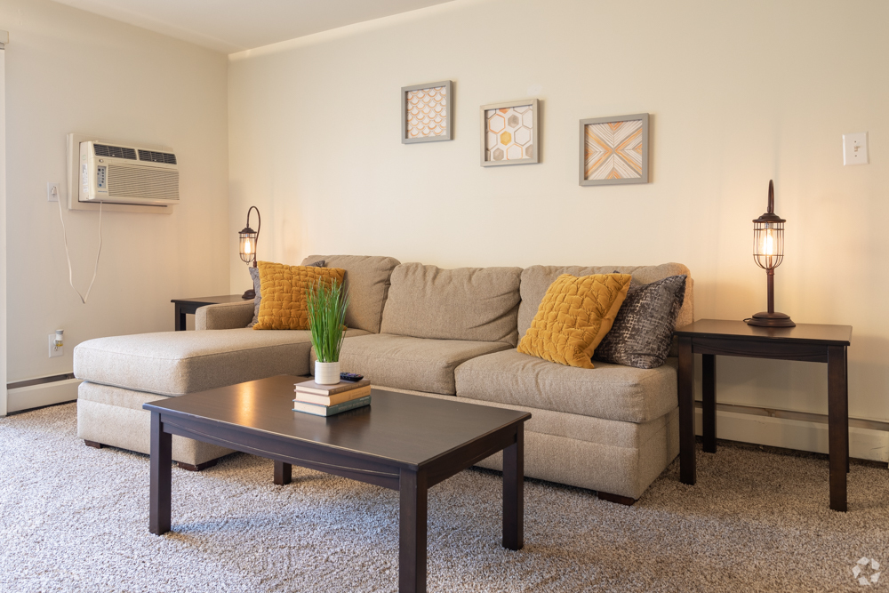 Furnished living room with air conditioning at Bishop Hill in Secane, PA