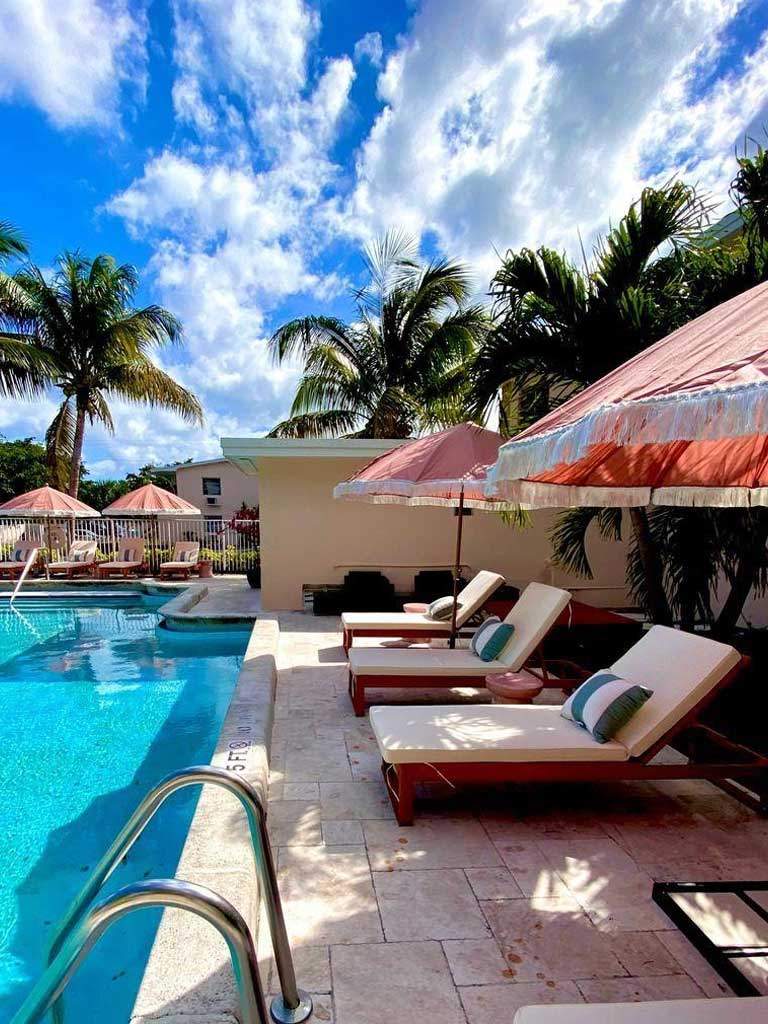 The Villas at Boynton Beach exterior pool with lounge chairs